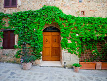 Vintage door in ancient building in Tuscany Royalty Free Stock Image