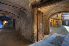 Vintage door and ancient passage in Saluzzo. Royalty Free Stock Image