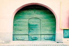 Vintage door through an arch Royalty Free Stock Photo