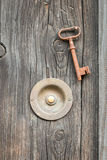 Vintage door bell with old key Royalty Free Stock Images