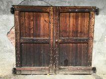 Vintage door and craftsmanship. Ancient door, wall, wood, art, history, beauty and craftsmanship Stock Image