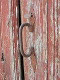 Vintage door detail. A door handle on a very old door Stock Photography