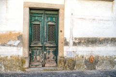 A vintage door on the facade of an old stone wall. A vintage door on the facade of an old stone wall stock photography