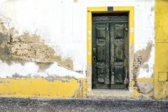 A vintage door on the facade of an old stone wall. A vintage door on the facade of an old stone wall royalty free stock photos