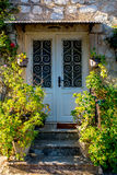 Vintage door with flowers Royalty Free Stock Photos