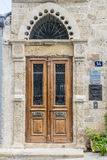 Vintage door and a fragment of the facade.  Royalty Free Stock Photography