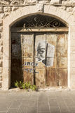 Vintage door and a fragment of the facade.  Royalty Free Stock Photo