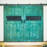 Vintage door on green cement Stock Photos