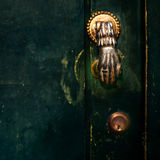 Vintage Door Handle with Dark Dusty Scratchy Texture/ black wall Royalty Free Stock Photo