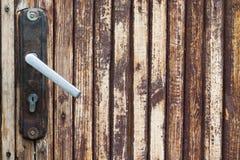 Vintage door handle, knob with lock. brown wooden tiles background. Stock Photo