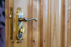 Vintage door handle on wooden doors close-up.  royalty free stock images