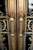 Vintage door handles on decorative doors Royalty Free Stock Images