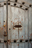 Vintage door in the house Antigua Guatemala. Vintage door with handle and letterbox slot in the house Antigua Guatemala Royalty Free Stock Images