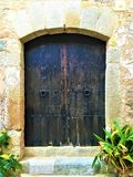 Vintage door, enchanting atmosphere, history and fairytale in Tossa de Mar, Spain. Vintage door, magic, enchanting details, fairytale, beauty, plants, entrance royalty free stock photography