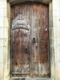 Vintage woodden door, enchanting details, history, time and fairytale in Tossa de Mar, Spain. Vintage door, magic, enchanting details, fairytale, beauty, plants royalty free stock image