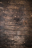 Vintage door protected with iron plates Royalty Free Stock Photo