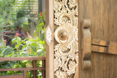 Vintage door of thai style home usage Stock Photos