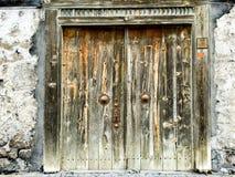 Vintage door. Wall stone old outdoor Stock Photos