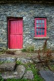 Vintage door and window on a facade of an old cottage in Ireland stock photos