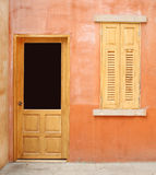 Vintage door and window on wall background Stock Images