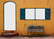 Vintage door and window on yellow wall. And space for texts stock photo