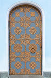 Vintage door with wrought ornament. Royalty Free Stock Photography
