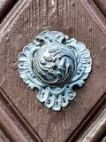 Vintage doorknob on antique door Royalty Free Stock Photography