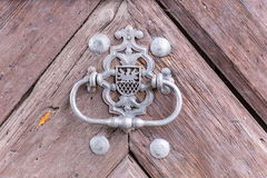 Vintage doorknob on antique door Royalty Free Stock Image
