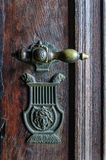 Vintage doorknob on antique door Royalty Free Stock Photos