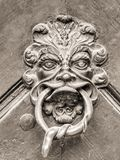 Vintage doorknob with face stock photos