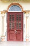 Vintage doors in front of building stock photos