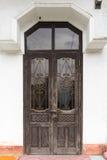 Vintage doors in front of building stock photo