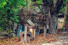 Vintage draw-well in the courtyard of the house. Closeup view stock image