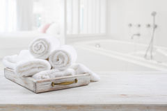 Vintage drawer with white towels over blurred bathroom and bedroom royalty free stock images