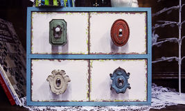 Vintage drawers and knobs. A set of vintage drawers found at a patchwork store Stock Images