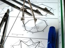 Vintage drawing tools. Over geometric draws stock photography