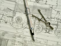 Vintage drawing tools. On vintage drawing background Royalty Free Stock Image