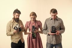 Vintage dressed company of photographers with old camera. Fashion Photographer with old film camera in hand while royalty free stock images