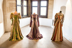 Vintage dresses. Three historical dresses on display in an ancient castle royalty free stock images