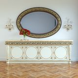 Vintage dressing table with roses on and mirror in carved frame Stock Image