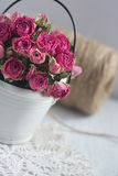 Vintage dried roses, napkin and tight twine Royalty Free Stock Images