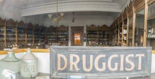 Vintage drug store interior. Vintage glass bottles of retro remedies inside old druggist store Royalty Free Stock Photography