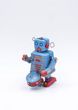 Vintage Drumming Robot Toy on a White Background.  Stock Images