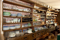 Vintage Dry Goods Store with glassware on display Royalty Free Stock Image