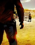 Vintage duel. Street of western town under the sunlight where two men are prepared for a duel confrontation Stock Image