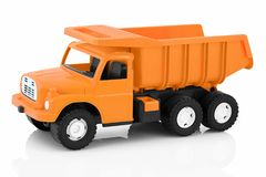Vintage dump truck isolated on white background with shadow reflection. Plastic child toy on white backdrop. Dump tipper truck lorry construction vehicle Royalty Free Stock Photo