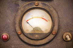 Vintage dusty volt meter in a metal casing. Vintage dusty volt meter in a black metal casing Stock Image