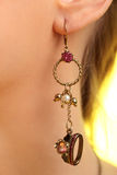Vintage ear ring purple gem Stock Image
