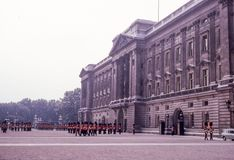 Vintage Early 1960`s Changing of the Guard at Buckingham Palace. Image taken from color slide Royalty Free Stock Images
