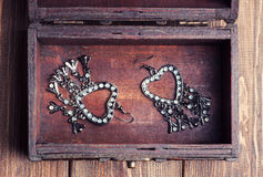 Vintage earrings in a form of hearts Stock Photos